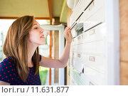 Купить «Pretty, young woman checking her mailbox for new letters», фото № 11631877, снято 17 июля 2018 г. (c) PantherMedia / Фотобанк Лори