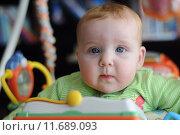 Купить «Close-up portrait of cute baby in play gym toy», фото № 11689093, снято 4 июля 2020 г. (c) PantherMedia / Фотобанк Лори