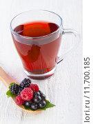 Купить «Fruit red tea with wild berries in wooden spoon on white wooden table», фото № 11700185, снято 23 марта 2019 г. (c) PantherMedia / Фотобанк Лори