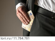 Купить «Businessman putting money in pocket», фото № 11784781, снято 19 августа 2018 г. (c) PantherMedia / Фотобанк Лори