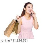 Купить «Asian woman shopping and talking on mobile phone isolated», фото № 11834761, снято 17 января 2020 г. (c) PantherMedia / Фотобанк Лори