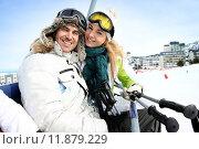 Купить «Couple of skiers sitting on liftchairs at snow resort», фото № 11879229, снято 24 июля 2019 г. (c) PantherMedia / Фотобанк Лори
