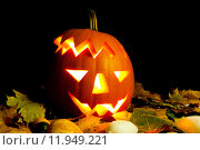 Купить «Lighting Helloween Pumpkin with autumn leaves with black background», фото № 11949221, снято 17 сентября 2018 г. (c) PantherMedia / Фотобанк Лори