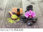 Купить «Orchid, bath salt, essential oil and black stones close-up», фото № 11954629, снято 19 марта 2019 г. (c) PantherMedia / Фотобанк Лори