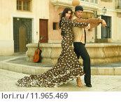 Купить «Mid adult man dancing with a young woman», фото № 11965469, снято 22 марта 2019 г. (c) PantherMedia / Фотобанк Лори
