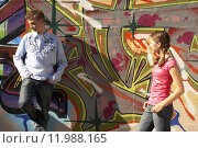 Купить «Two teenagers standing against a mural.», фото № 11988165, снято 20 апреля 2018 г. (c) PantherMedia / Фотобанк Лори