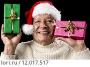 Купить «Kind Aged Gentleman With Red Cap Raising Two Gifts», фото № 12017517, снято 7 августа 2020 г. (c) PantherMedia / Фотобанк Лори