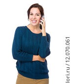 Купить «Woman talk to mobile phone», фото № 12070061, снято 17 января 2020 г. (c) PantherMedia / Фотобанк Лори
