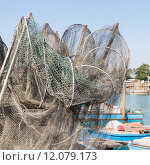 Купить «fishing nets, creels and fishing boats», фото № 12079173, снято 19 ноября 2018 г. (c) PantherMedia / Фотобанк Лори