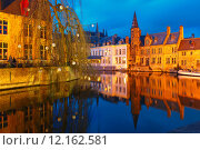 Купить «Cityscape with a tower Belfort from Rozenhoedkaai in Bruges at s», фото № 12162581, снято 24 января 2019 г. (c) PantherMedia / Фотобанк Лори