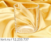 Купить «Photo Of Single Glass At Golden Drapery Background», фото № 12233737, снято 17 июня 2019 г. (c) PantherMedia / Фотобанк Лори