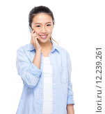Купить «Young woman talk to cellphone», фото № 12239261, снято 17 января 2020 г. (c) PantherMedia / Фотобанк Лори