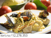 Купить «valenciana paella with some of its traditional ingredients or rather fish vegetable and meat», фото № 12278353, снято 19 марта 2019 г. (c) PantherMedia / Фотобанк Лори