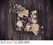 Купить «Wooden box with laces, ribbons and threads», фото № 12289805, снято 18 февраля 2019 г. (c) PantherMedia / Фотобанк Лори