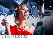 Купить «Asian singer producing song in recording studio», фото № 12336521, снято 16 февраля 2019 г. (c) PantherMedia / Фотобанк Лори
