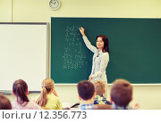 Купить «school kids and teacher writing on chalkboard», фото № 12356773, снято 15 ноября 2014 г. (c) Syda Productions / Фотобанк Лори