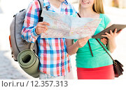 Купить «smiling couple with map and backpack in city», фото № 12357313, снято 7 июля 2014 г. (c) Syda Productions / Фотобанк Лори