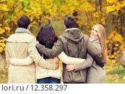 Купить «group of smiling men and women in autumn park», фото № 12358297, снято 4 октября 2014 г. (c) Syda Productions / Фотобанк Лори