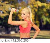 Купить «young sporty woman with light dumbbell», фото № 12360205, снято 8 мая 2014 г. (c) Syda Productions / Фотобанк Лори