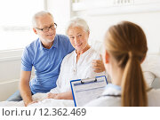 Купить «senior woman and doctor with clipboard at hospital», фото № 12362469, снято 11 июня 2015 г. (c) Syda Productions / Фотобанк Лори