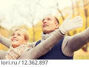 Купить «smiling couple in autumn park», фото № 12362897, снято 12 октября 2014 г. (c) Syda Productions / Фотобанк Лори