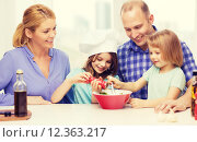 Купить «happy family with two kids making dinner at home», фото № 12363217, снято 1 марта 2014 г. (c) Syda Productions / Фотобанк Лори