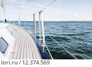 Купить «close up of sailboat or sailing yacht deck and sea», фото № 12374569, снято 13 июля 2014 г. (c) Syda Productions / Фотобанк Лори