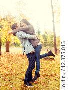 smiling couple hugging in autumn park. Стоковое фото, фотограф Syda Productions / Фотобанк Лори