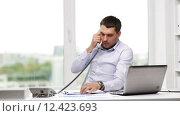 Купить «angry businessman with laptop calling on phone», видеоролик № 12423693, снято 9 июля 2015 г. (c) Syda Productions / Фотобанк Лори