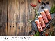 Купить «Top view of sliced prosciutto with space for your text», фото № 12469577, снято 21 июля 2019 г. (c) PantherMedia / Фотобанк Лори