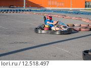 Купить «Man driving fast a Kart in a circuit lap in Kharkiv», фото № 12518497, снято 20 августа 2018 г. (c) PantherMedia / Фотобанк Лори