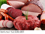 Купить «Assorted meat products including ham and sausages», фото № 12530081, снято 20 марта 2019 г. (c) PantherMedia / Фотобанк Лори