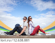 Купить «teenagers sitting back to back», фото № 12638881, снято 20 июля 2013 г. (c) Syda Productions / Фотобанк Лори