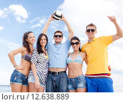 Купить «group of happy friends with beach ball», фото № 12638889, снято 31 августа 2013 г. (c) Syda Productions / Фотобанк Лори