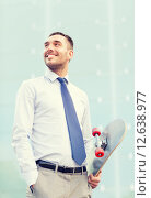 Купить «young smiling businessman with skateboard outdoors», фото № 12638977, снято 19 августа 2014 г. (c) Syda Productions / Фотобанк Лори