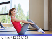Купить «smiling woman doing exercises on mat in gym», фото № 12639133, снято 7 июня 2014 г. (c) Syda Productions / Фотобанк Лори