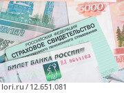 Купить «Пенсионное страховое свидетельство и рубли», фото № 12651081, снято 1 сентября 2015 г. (c) Александр Лычагин / Фотобанк Лори