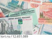 Купить «Пенсионное страховое свидетельство и рубли», фото № 12651089, снято 1 сентября 2015 г. (c) Александр Лычагин / Фотобанк Лори