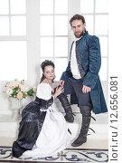 Купить «Мужчина и женщина в средневековой одежде», фото № 12656081, снято 23 августа 2015 г. (c) Darkbird77 / Фотобанк Лори