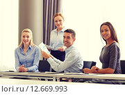 Купить «smiling business people with papers in office», фото № 12669993, снято 25 октября 2014 г. (c) Syda Productions / Фотобанк Лори