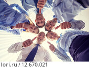 smiling group of businesspeople standing in circle. Стоковое фото, фотограф Syda Productions / Фотобанк Лори