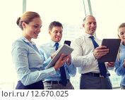 Купить «business people with tablet pc and smartphones», фото № 12670025, снято 25 октября 2014 г. (c) Syda Productions / Фотобанк Лори