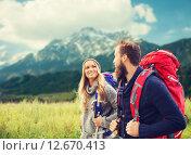 Купить «smiling couple with backpacks hiking», фото № 12670413, снято 31 августа 2014 г. (c) Syda Productions / Фотобанк Лори