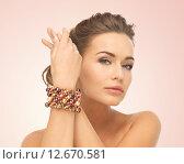 Купить «woman wearing bracelet with beads», фото № 12670581, снято 17 марта 2013 г. (c) Syda Productions / Фотобанк Лори