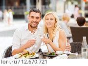 Купить «happy couple clinking glasses at restaurant lounge», фото № 12670721, снято 15 июля 2015 г. (c) Syda Productions / Фотобанк Лори