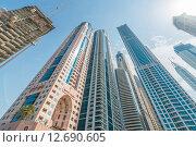 Купить «Dubai - AUGUST 9, 2014: Dubai Marina district on August 9 in UAE. Dubai is fastly developing city in Middle East», фото № 12690605, снято 9 августа 2014 г. (c) Elnur / Фотобанк Лори