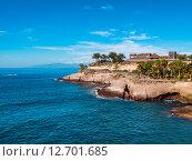 Купить «Вид на древний замок. Расположенный между пляжей El Duque и Fanabe в Тенерифе. Канарские острова. Испания», фото № 12701685, снято 20 декабря 2014 г. (c) Alexander Tihonovs / Фотобанк Лори