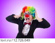 Купить «Woman clown businesswoman isolated on white», фото № 12726049, снято 8 мая 2013 г. (c) Elnur / Фотобанк Лори