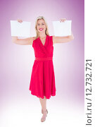 Stylish blonde in red dress holding pages. Стоковое фото, агентство Wavebreak Media / Фотобанк Лори