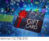 Купить «Composite image of santa flying his sleigh behind gift card», фото № 12738313, снято 18 июня 2019 г. (c) Wavebreak Media / Фотобанк Лори